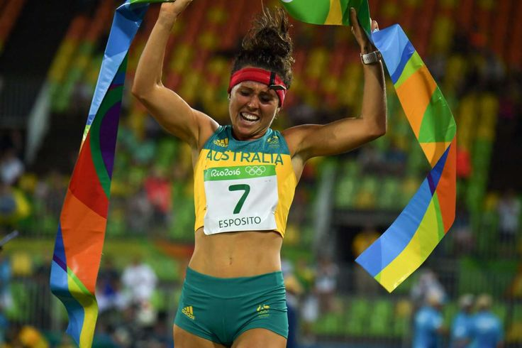 Excellent at everything: Australia's Chloe Esposito crosses the line to win the combined running/shooting portion of the women's modern pentathlon event in Rio de Janeiro, on Aug. 19. Esposito won the gold medal.
