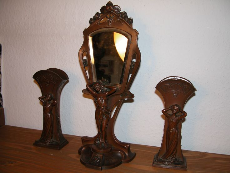 Dressing table set, mirror with two vases. Art Nouveau period. Made of zamac. Height, 33 cm.