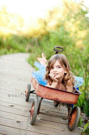 cute little girl pic in a little red wagon