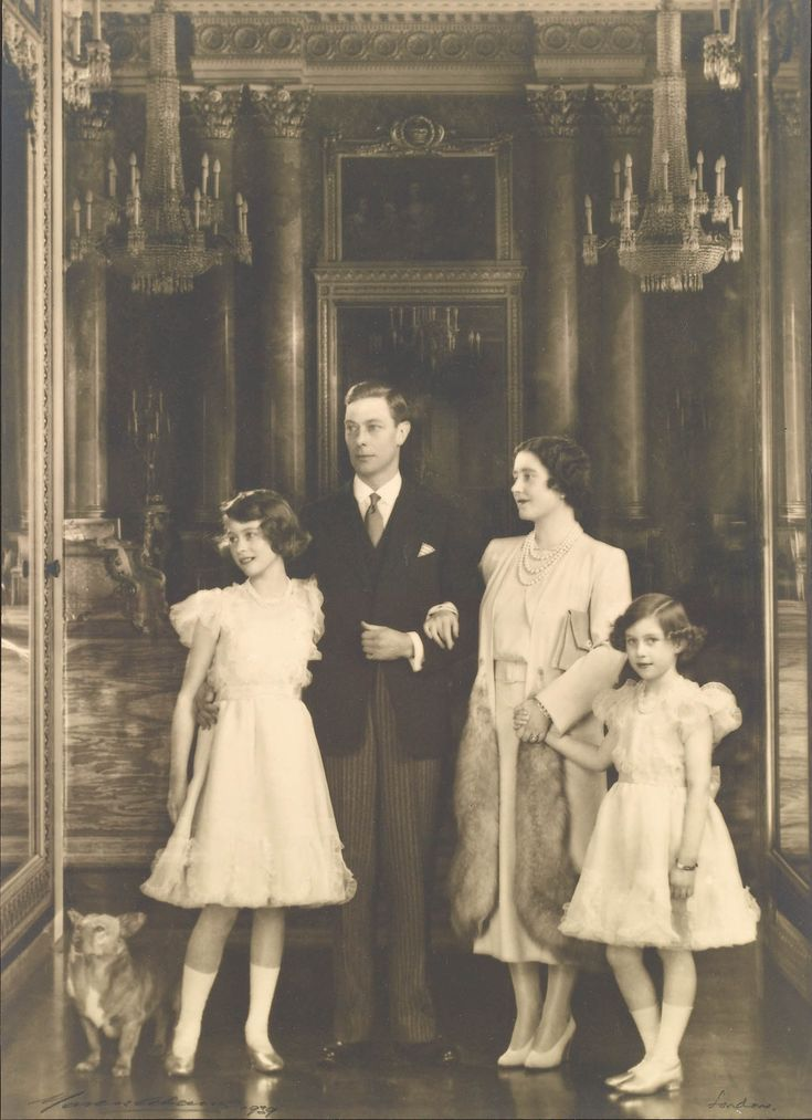 The Royal Family, including Dookie, at Buckingham Palace, 20 December 1938 | Royal Collection Trust Photograph of a full length group portrait of the Royal Family taken in Buckingham Palace with (from left to right): Dookie the corgi, Princess Elizabeth (b. 1926) now HM Queen Elizabeth II, King George VI (1895-1952), Queen Elizabeth (1900-2002) and Princess Margaret (1930-2002).