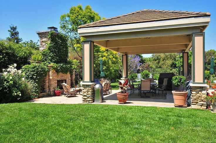 Transitional Patio with exterior tile floors, outdoor pizza oven, Paint1, Fence