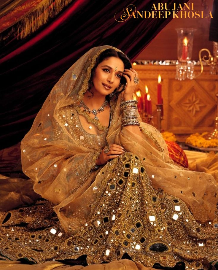 "MIRRORED SPLENDOUR Madhuri Dixit - Nene as ""Chandramukhi"" in an ensemble commissioned exclusively for Devdas. Abu Jani Sandeep Khosla won the National Award for the film's Costume Design."