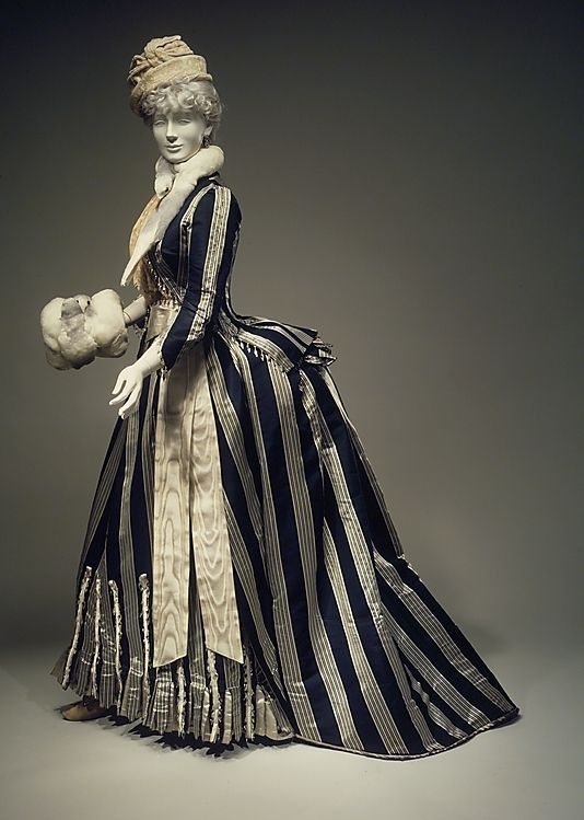 Walking dress from the House of Worth. 1885. Silk with glass bead trim.