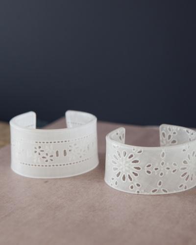 Shrinky Dink bracelets with a lace pattern.  Like I need more shrinky dink inspiration!!