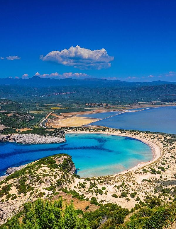 This is what paradise looks like from above. Ice-Blue Voidokilia Beach, Messinia Greece. The Road Less Traveled: 5 Must Visit Travel Destinations on Greece's Mainland on TheCultureTrip.com. (Image via polopixel.com)