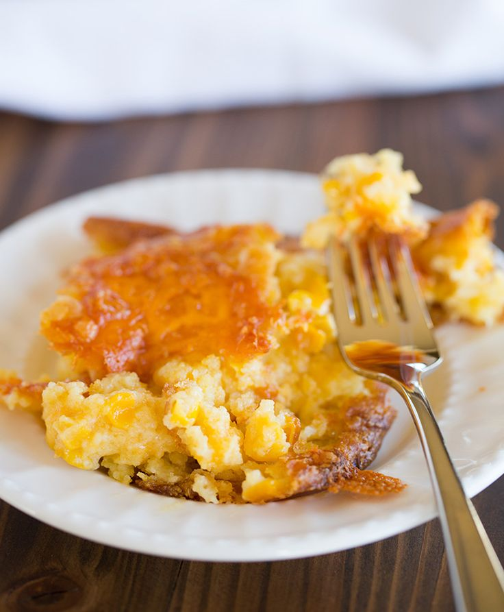 Cheesy Creamed Corn Casserole - super easy, mixes together in 5 minutes, and is the perfect side dish for all of your holiday dinners.  via @browneyedbaker