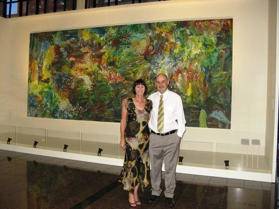 Tim and Jan Jennings in front of Earth's Creation at Parliament House in Darwin.