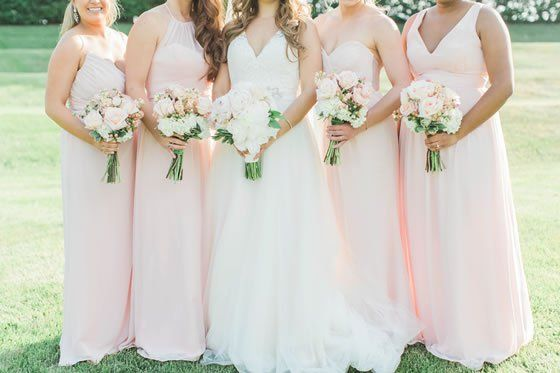 The bridesmaids look lovely in their pale pink dresses, each with its own unique style | Soft and Romantic Virginia Country Club Wedding | Regency at Dominion Valley | Jillian Michelle Photography