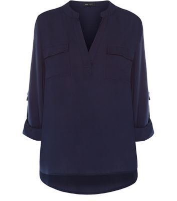 """For a chic casual look team this utility shirt with black skinny jeans and block heels.- 3/4 sleeves- Soft cotton blend- Casual fit- Pocket detail- V neckline- Model is 5'8""""/176cm and wears UK 10/EU 38/US 6"""
