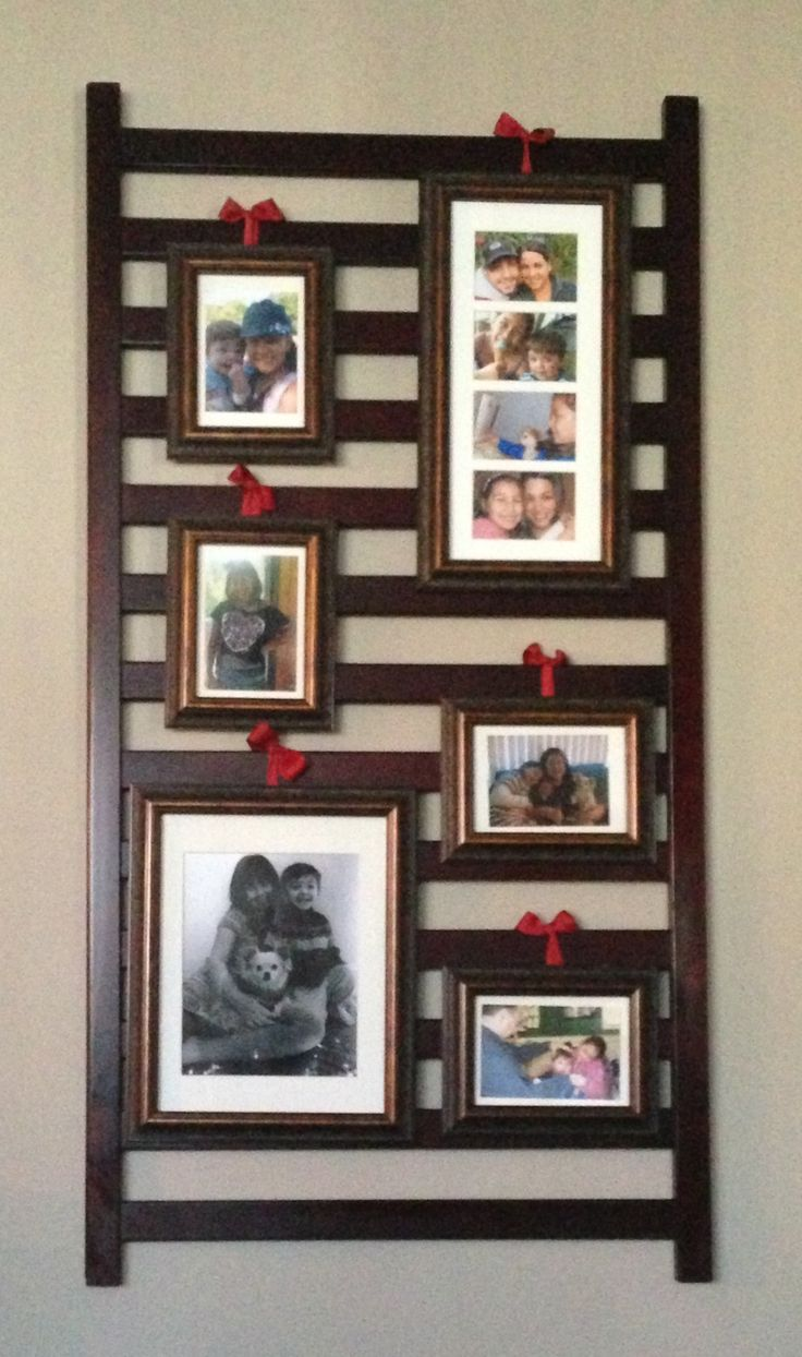 Hanging picture frames on an old crib rail! Decorative and sentimental!
