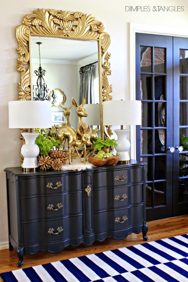 love the blue french doors to the entry and the blue chest