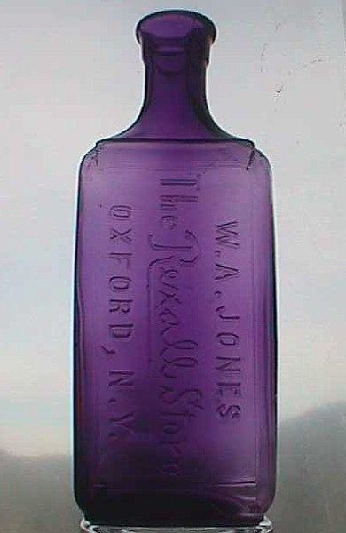 Antique purple apothecary bottle from W.A. JONES Rexall Store in Oxford, NY
