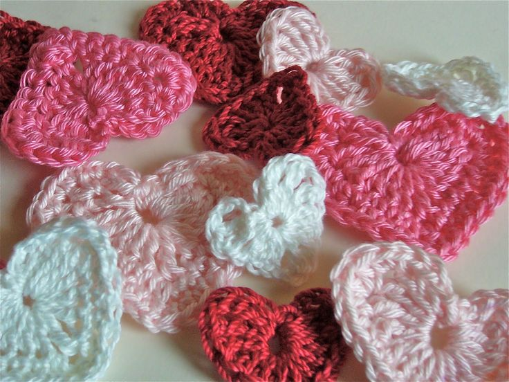 Supplies used:  Size D crochet hook  Size 3 crochet thread or embroidery floss  (Or use any size hook/yarn you have on hand--it will just change the size)    All stitches worked into the first chain.    Crocheted hearts   Ch 4. Work 3 tr (triple crochet) into first ch, 3 dc, ch 1, 1 tr, ch 1, 3 dc, 3 tr. Ch 3, sl st into center and fasten off.