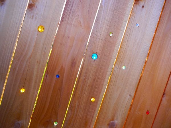 If I should ever have a fence, I will not hesitate to drill some holes and stick some marbles in it.