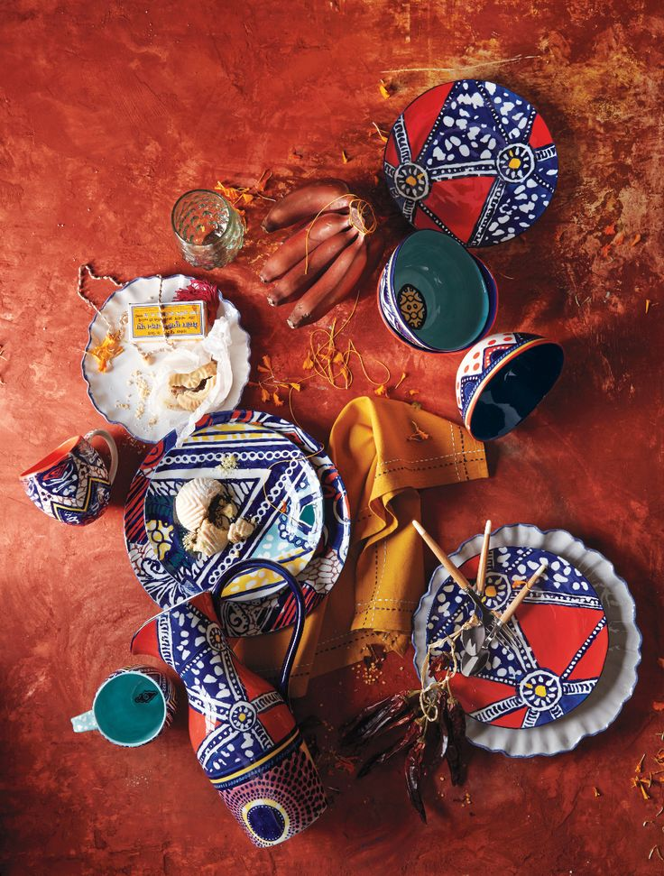 The bright, handpainted patterns on the Habari Dinnerware would pop next to metallic gold flatware; perfect for your next dinner party.