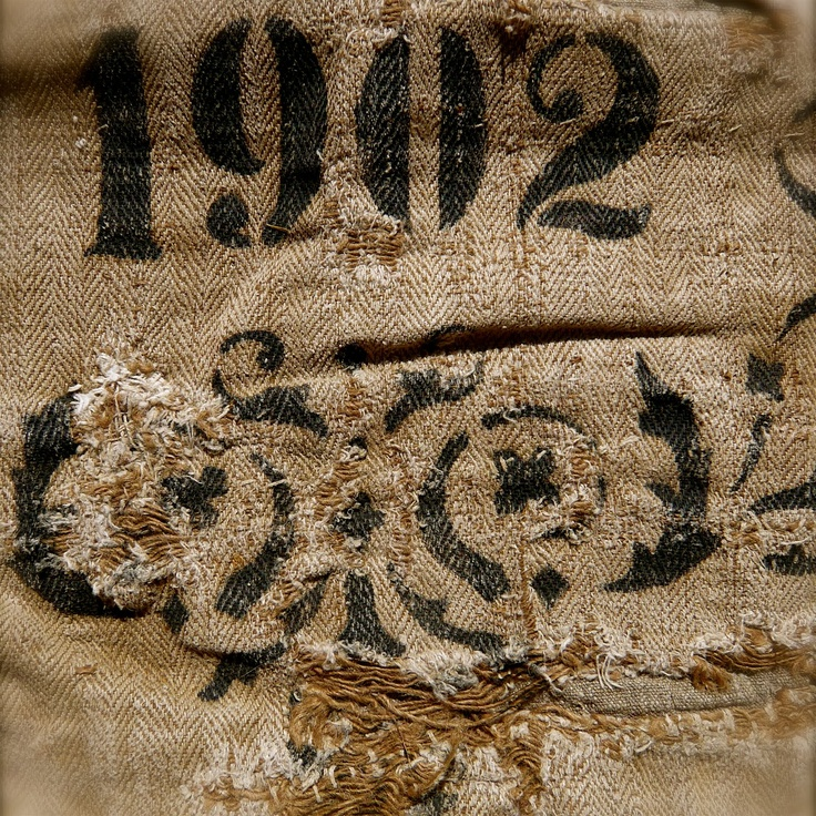 ....burlap.. frayed..stenciled