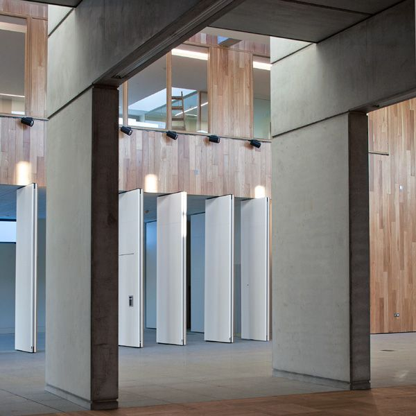 . On the other side of the internal street a large reading room is accessed through a series of concrete fins and a change in the ceiling heights denotes a quieter area