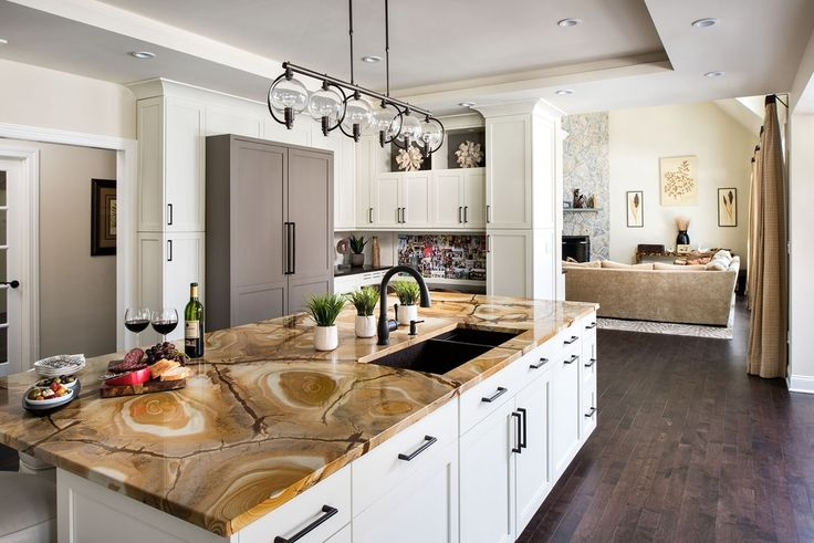Consider onyx countertops for your kitchen islands -- the result is a classy, unexpected addition to the room.