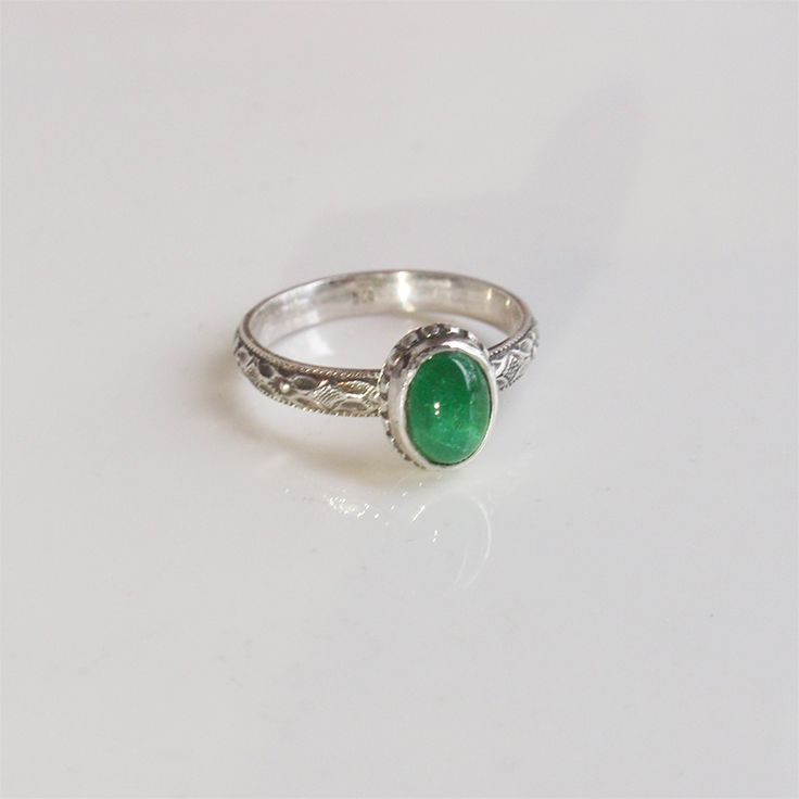 Sterling silver and natural Brasil emerald ring