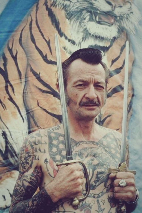 """Old """"vintage"""" tattooed circus guy."""