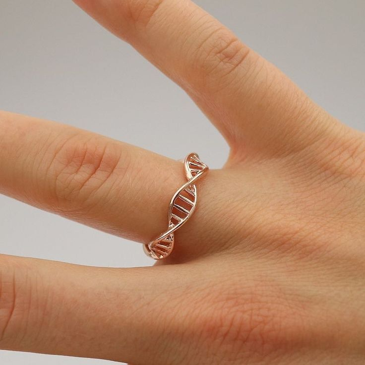 Still one of our best selling products: DNA double helix ring (in rose gold on the picture) Available plated in silver gold and rose gold at moleculestore.com  #molecule #chemistry#chemist #science #scientist #molecules #orgchem #chemical #biology #dna #doublehelix #helix #chemistryring #staynerdy