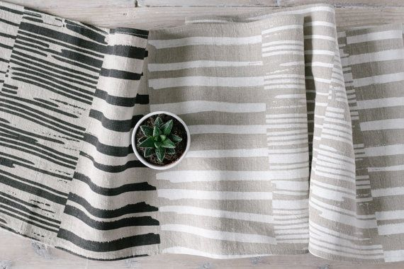 Dress up your table in simple, modern style with this 100% prewashed linen table runner, hand printed with organic inks. This Rows pattern is inspired by the designer's coastal surroundings. Find yours at keephousestudio on Etsy