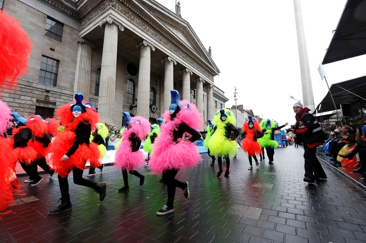 Colourful performers entertain the crowd at the Grandstand outside the GPO