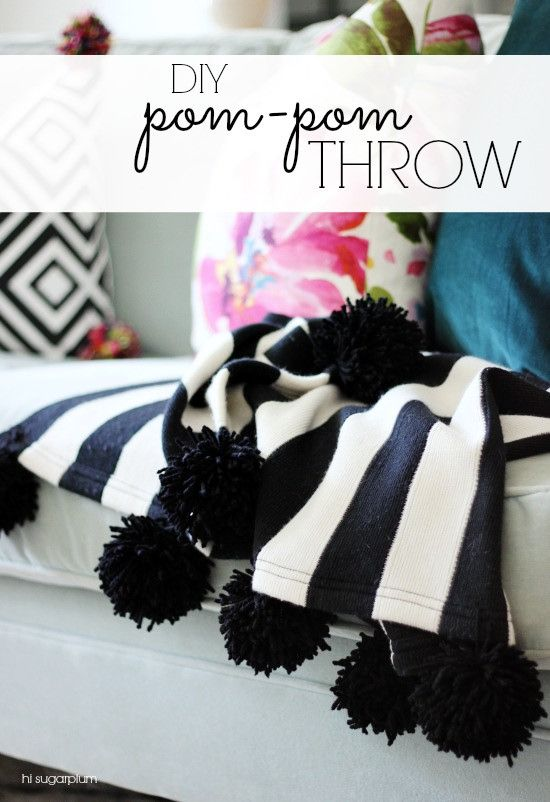 DIY Pom Pom Throw – Great way to update an old blanket!