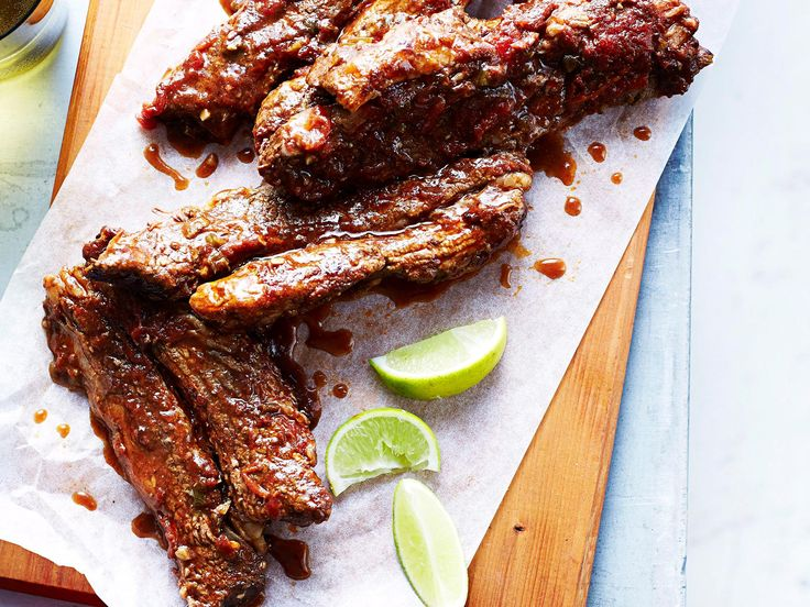 Don't forget the finger bowls when you serve these sticky ribs that are dripping with Mexican flavours. The peppery radish salad beautifully balances the sweetness of the ribs.