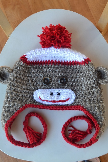 Sock Monkey Hat. I'd SOOOOOOOOOOO wear one if it was grey and/or black!!! Maybe navy blue to match my favorite knitted winter scarf!!!