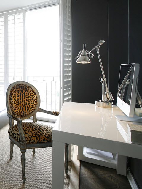 Home office with white parson's desk and leopard animal print chair. Ashley