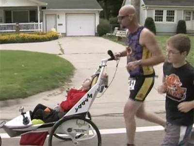Dad competes in triathlons with severely disabled daughter