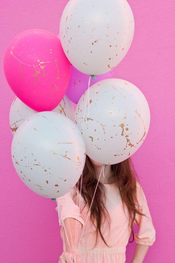 cute party decor idea: diy gold splatter balloons