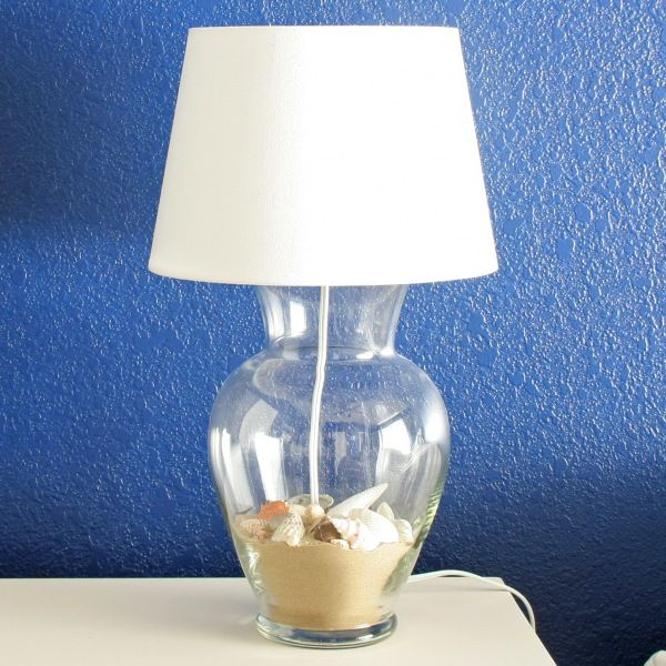 How to make a lamp using a glass vase (super cheap at yardsales). You can fill it with whatever you want! They used sand and seashells.