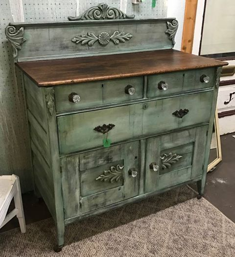 I painted the base coat of this antique buffet with a mix of Dixie Belle Blue and Driftwood. Then dry brushed it with Drop Cloth and accented the corners, wood details and drips with Palmetto. I distressed it and used clear and brown wax. This was a fun piece to work on and I LOVE Dixie Belle paint products! #ladonsrecreations