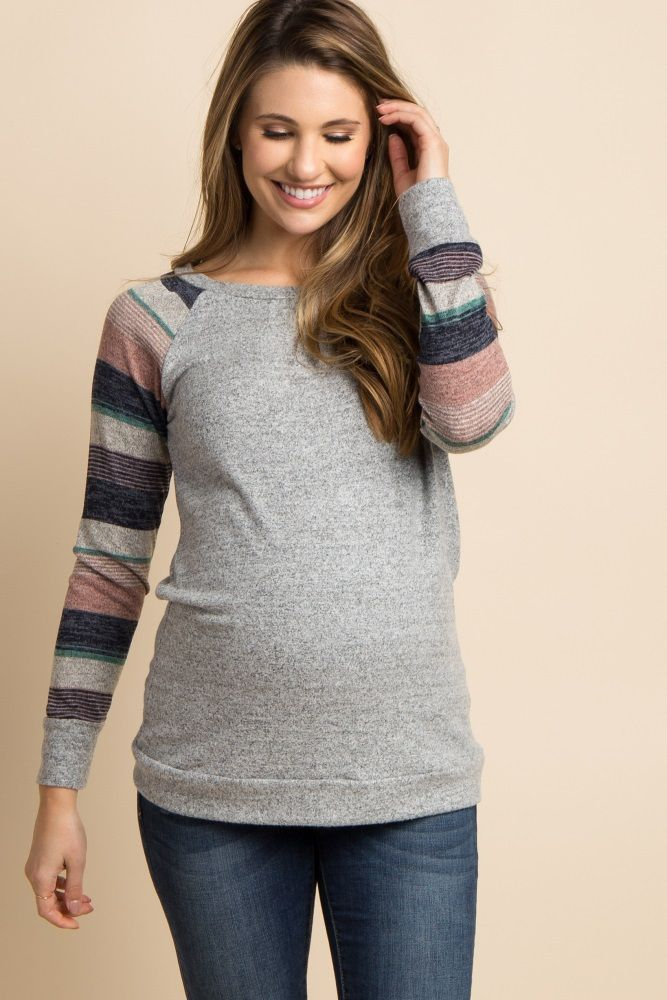Featuring all our favorite accents, this maternity top is the perfect essential for fall. A fun striped sleeve and a super soft material makes this top the perfect piece to transition from one season into the next. Style it with your favorite maternity jeans and flats for a feminine look you can wear to any occasion. #pregnancyclothes,