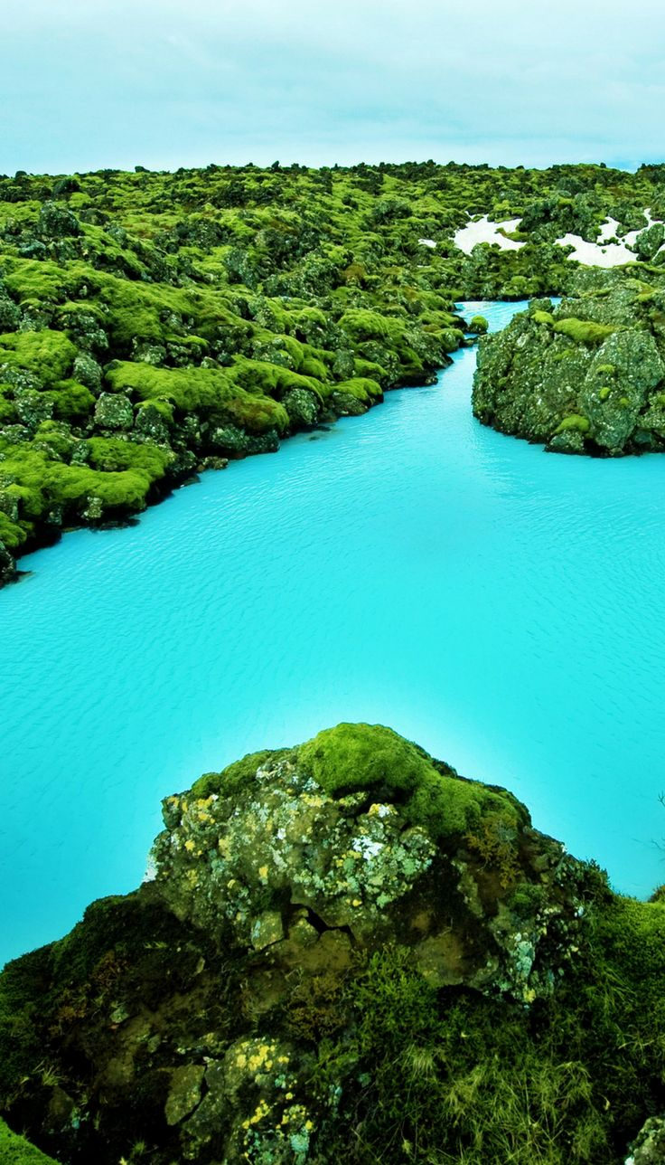 Blue Lagoon in Iceland!  One of the top things to see when traveling to Iceland!  Click through to get more details on what it is like to visit the Blue Lagoon.