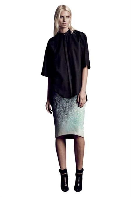The lucid After glow print is inspired by the concept a skirt dipped delicately in print. The fresh mint and white are illuminated against a deep charcoal textural base .The chic pencil skirt silhouette is shaped down slightly at the back for a flattering line.  The rose gold zip and leatherette waistband give a luxe factor to this classic pencil skirt. We love this skirt with a sling back, slouchy sweater and python black Sonic clutch. #GingerandSmart