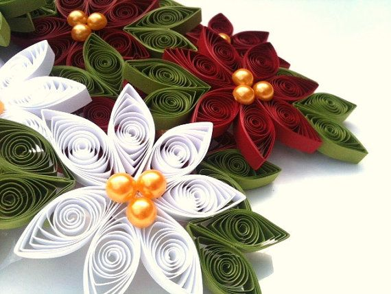 Poinsettia Christmas Ornament Paper Quilled Each flower measures between 3.5 - 4.5 inches from leaf to leaf and is approximately 1/4 inch thick. Three gold colored half 'pearls' adorn the center of each flower.