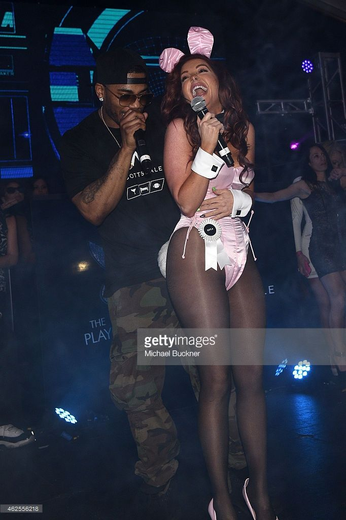 Rapper Nelly and Kayla Collins perform onstage at the Playboy Party at the W Scottsdale During Super Bowl Weekend, on January 30, 2015 in Scottsdale, AZ.