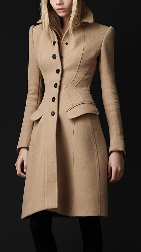Bound in a sculpted Burberry crêpe wool coat.