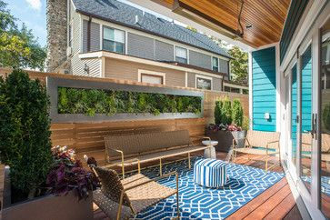 16 Ways to Get More from Your Small Backyard - like the stainless frame for the living wall