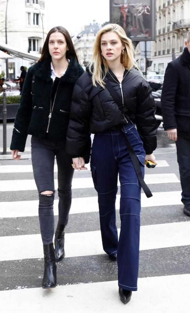 Nicola Peltz Wearing A Black Cropped Puffer Jacket White Square Neck Cropped T Shirt Wide Leg Cargo Jeans Black Platfor Fashion Puffer Jacket Outfit Outfits