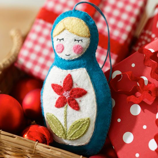 A Felt Nesting Doll Ornament will add old-world style to your Christmas tree: http://www.bhg.com/christmas/crafts/make-christmas-ornaments-with-felt/?socsrc=bhgpin112313feltnestingdollornament&page=27