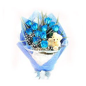 The blue-and-white hand bouquet of one dozen Blue Roses comes with Bay Grass, Baby's Breath and a small Plush White Bear. http://www.pickupflowers.com/send-roses-to-malaysia