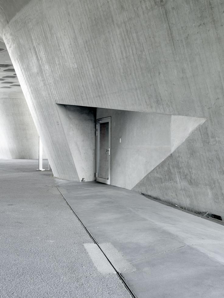 Phaeno Science Centre, Wolfsburg, Germany - Zaha Hadid.  How do you put ordinary things (like doors!) into extraordinary shapes?