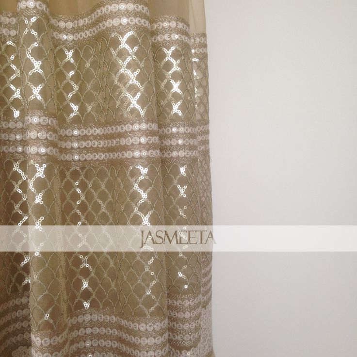 Our beautiful beige net fabric, embroidered with ivory work. So stunning!
