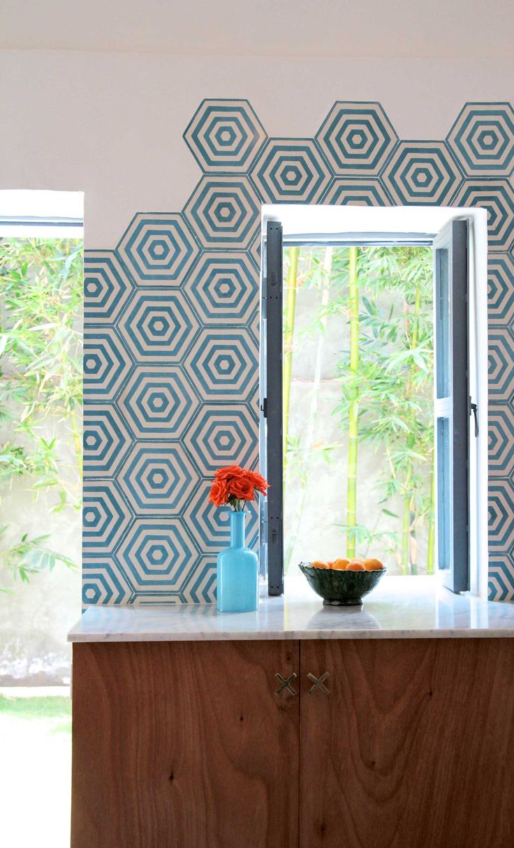 Current, exciting design products. This is the Hex Target cement tile in azure and milk from Popham Design. Handmade in Morocco.