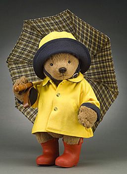 "RJW Dolls presents - Rainy Day Paddington 15"" tall, fully jointed, alpaca plush with glass eyes and leather nose. Wearing cotton duck raincoat, hat, and custom-made rubber boots. Includes custom wood and metal working umbrella with plaid cotton fabric and leather strap.  Date of Release: 2002  Limited Edition 500.  NOTE: The outfit only was also sold separately."