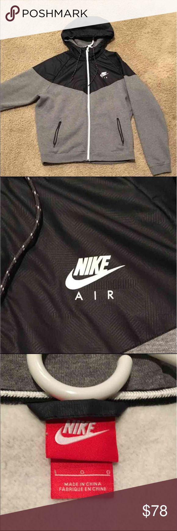 Grey and black Nike air jacket Excellent condition ~ worn 3 times  Thick, high-quality coat  Zip-up jacket  Hooded  SIZE LARGE  sold out everywhere. RARE  Too small for my brother now- selling it for him  Thanks for looking feel free to ask questions :)  ORIGINALLY $110 Selling for 69 on merc :)  Nike. Lululemon. Adidas. Underarmour. Nike Jackets & Coats Performance Jackets